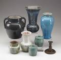 Pisgah forest etc nine items seven pisgah forest vases and covered jars together with a vase and single candlestick by other maker all marked