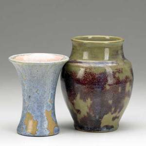Pisgah forest two vases one corseted covered in ivory and blue crystalline glaze 1948 the other in plum and olive green several lines around rim of corseted pisgah marks corseted dated bulbous