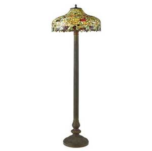 Chicago mosaic floor lamp with a leaded glass shade of cherry branches over a threesocket column brass base with painted details a few short breaks to glass stamped with a circle inside a shield