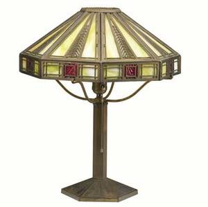 Bradley  hubbard brass table lamp in stlylized feather motif its faceted shade lined in lime green and ruby red slag glass shade and base stamped bradley  hubbard mfg co 19 x 15