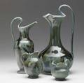 Chelsea keramic art works four pitchers in green and brown flambe glaze each stamped ckaw half of a dedham 1968 exhibition stamp on one tallest 11 14