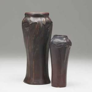 Van briggle two vases covered in persian rose glaze one with daffodils the other with dragonflies small chip to base of latter both marked 9 12 and 6 34