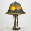 Pairpoint table lamp with a bellshaped reversepainted textured glass shade in a mountainous landscape motif over a brasswashed threesocket classical base base marked pairpoint d3070 22 12 x