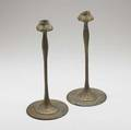 Jarvie attr pair of bronze candlesticks embossed with spadeshaped leaves cleaned patina some verdigris missing bobeches unsigned 13 34