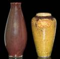 Dedham  chelsea keramic art works two experimental vases by hugh robertson one covered in lustered oxblood glaze the other in amber orange peeltexture finish 1 t line to former 2 12 kiln kiss