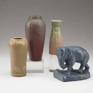 Rookwood four production items three vases including one with rooks and a single elephant bookend all marked tallest 7 14