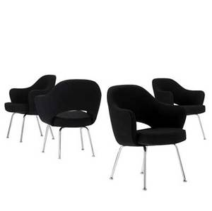 Eero saarinen  knoll set of four armchairs upholstered in black wool on chromeplated steel legs all with knoll upholstery labels 31 34 x 26 12 x 20 12