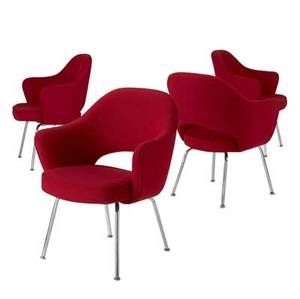 Eero saarinen  knoll set of four armchairs upholstered in red wool on chromeplated steel legs all with knoll upholstery labels 31 34 x 26 12 x 18 12