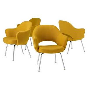 Eero saarinen  knoll set of four armchairs upholstered in yellow wool on chromeplated steel legs all with knoll upholstery labels 31 34 x 26 12 x 18 12