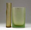 Venini two satinfinished glass vases one cylindershaped in light amber ego designed by p farina 2004 the other of elliptical shape with ribs in light green 2001 both signed and dated als