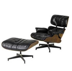 Charles and ray eames  herman miller rosewood plywood lounge chair and ottoman nos 670671 upholstered in black leather black and white circular metal tag chair 32 12 x 32 33 ottoman 17