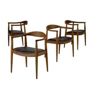 Style of hans wegner set of four walnut chairs with dark brown leather seats 29 12 x 24 12 x 20