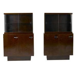 Gilbert rohde  herman miller pair of mahogany burled walnut and rosewood etageres with steel pulls and interior adjustable shelves each with glass doors and single shelf 58 x 36 x 16 12