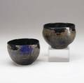 Toshiko takaezu two porcelain bowls covered in gunmetal and lapis blue glazes provenance collection of hope and jay yampol both signed tt each approximately 3 12 x 4 34
