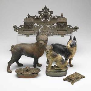 Metalware six pieces includes two boston terrier doorstops two brass inkwells brass blotter and an unknown breed dog doorstop largest 17 x 9