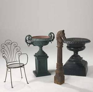 Cast iron garden accessories five pieces including a pair of urns one signed fiske horse hitching post and a garden armchair largest urn 26 x 30 dia
