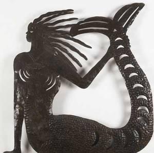 Folk art sculpture of a mermaid with flowing hair in sheet metal 33 x 31