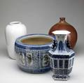 Asian porcelain chinese blue and white jardiniere and vase together with an oxblood ovoid vase and white vase tallest 16