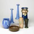 Weller etc seven vessels six weller including a 9 34 baldin vase and a pair of tall candlesticks and a peters  reed bowl some nicks on a few pieces some marked