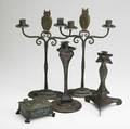 Buffalo art crafts shop etc two enameled triangular candlesticks and a box two marked together with a pair of hammered wrought iron candlesticks with owl finials marked for the jones iron works