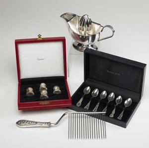 Sterling and silver plate tiffany cartier etc serving pieces and flatware twelve pieces include silver plate art deco juicer whiting iris pattern sterl holloware 10 12 cake breaker two pai