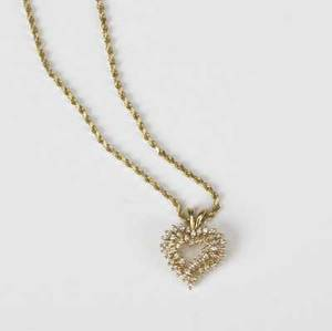 Gold and diamond heart pendant on a 14k yg gold rope chain with 10 ct diamonds