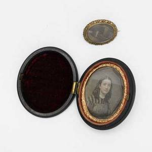 19th c daguerreotype and hair jewelry depicting a young woman in period dress together with an oval brooch with braided brunette hair daguerreotype 2 14 x 1 12
