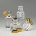 Devilbiss etc two perfume atomizers one squat with crackled gold iridescent glaze the other in clear and frosted glass with foliate design together with three other perfumes tallest 4