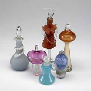 Perfume bottles group of six includes blue jade glass frosted glass with snake decoration figural bottle in the shape of a woman and bottle with devil head stopper some signed tallest 11