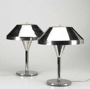 Nessen pair of chrome table lamps with nessen label together with a pair of cast stone table lamps