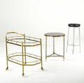 Hoegger chrome stool with black leather seat together with jansen style side table in chrome and brass with black bakelite top and an italian brass and glass bar cart table 26 20 12 dia