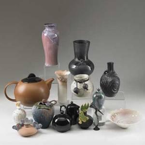 Art pottery box lot fifteen pieces includes three perfumes blackware tea set and vases tallest 8 12