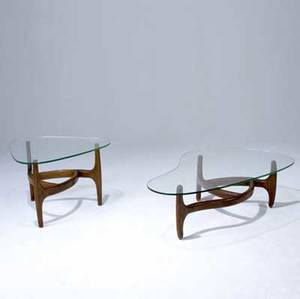 Style of kagan freeform coffee table together with a matching side table each with walnut frame and glass top coffee table 15 x 51 12 x 31