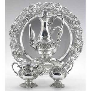 Redlich  co art nouveau silver coffee service retailed by je caldwell  co ca 1900 raised and applied daisy motif with scroll handles and ivory insulators 15 12 tray 3915 10 12 coffee