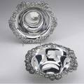 Tiffany  co silver bowls two clover pattern bowls each having scrolling everted rim richly decorated with blossoms and leaves ca 1898 245 ot 2 12 x 9