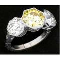 Art deco natural yellow diamond ring fancy yellow oec diamond 830mm x 910mm x 514mm 275 cts by formula in hexagonal bezel setting flanked by two near colorless oec diamonds approx 24 cts