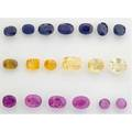 Unmounted pink yellow and blue sapphires six pink gems 1193 cts tw six yellow gems 138 cts tw seven blue gems 114 cts tw in faceted oval circular cushion and emerald cuts