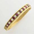 Aire ny hinged diamond and ruby bangle eleven fine brillant cut diamonds 161 cts tw alternate with thirteen graduated oval synthetic rubies 385 gs gw internal circumference 2 34