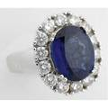 Large oval sapphire and diamond cluster ring 18k wg ca 1995 bright oval faceted blue sapphire 124 mm x 965 mm fourteen circular brilliant cut diamonds approx 140 cts tw 112 gs gw size 7