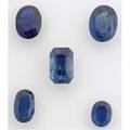 Five fine unmounted faceted blue sapphires emerald cut 6 cts 112mm x 746mm x 66mm four oval cut gemstones 135 cts tw largest 505 cts 116mm x 9mm 195 cts tw