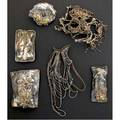 Marci zelmanoff silver mixed metal jewelry 19781980 five forged and chased sterling brooches and a pendant with wrapped fine silver wire accompanied by photo collages three signed largest 5 1