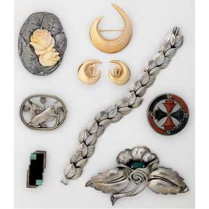 Gold and silver jewelry in the arts  crafts tradition nine pieces jensen fawn brooch 256 postwar mark han hansen 14k brooch and ear clips adolf meyer frankfurt 900 silver and carved ivory broo