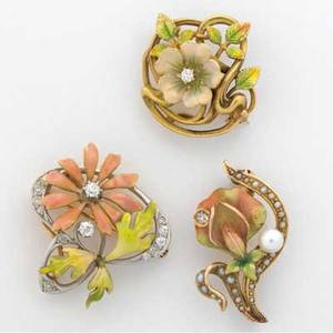 Three american art nouveau enameled gold flower brooches with diamonds ca 19101920 one pt topped by krementz 14k yg 145 gs gw largest approx 1