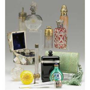 Perfume grouping twelve pieces includes bottles atomizers vials fourpiece set in motherofpearl box 1922 caron in box daum nancy attrib r lalique etc