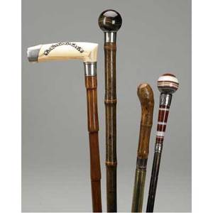 Walking sticks and canes sword cane silverencrusted ivory cane and two hardstone walking sticks with silver mounts 19th20th c longest 37
