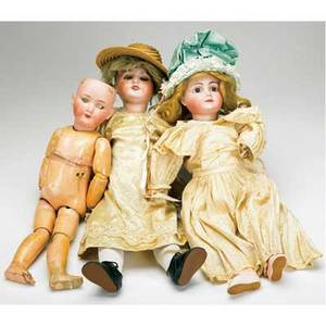 Bisque head dolls grouping of three late 19thearly 20th c sfbj paris 60 with blue sleep eyes and body bisque head marked 10 with fixed blue eyes and pierced ears possibly jumeau marked jum