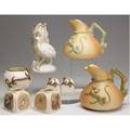 Royal worcester grouping includes two dragon pitchers one bird figural vase three smaller dragon decorated jars and two jars with bee decoration all late 19thearly 20th c tallest 6 34