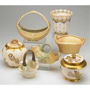 Royal worcester grouping includes two covered jars four baskets and vase all late 19thearly 20th c tallest 7 34