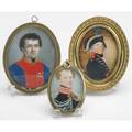 Portrait miniatures three portraits of military gentlemen on ivory in oval brass frames late 18thearly 19th c largest 2 12 x 3 14