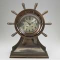 Chelsea ships clock with bronze case time and strike and ships wheel decoration 17 12